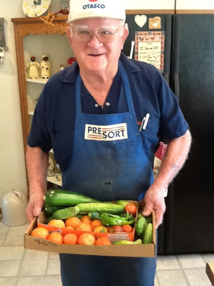 Dad showing of his garden harvest