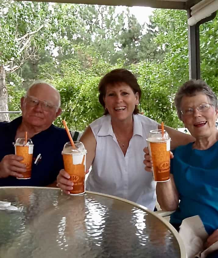 Enjoying root beer floats on the patio with parents