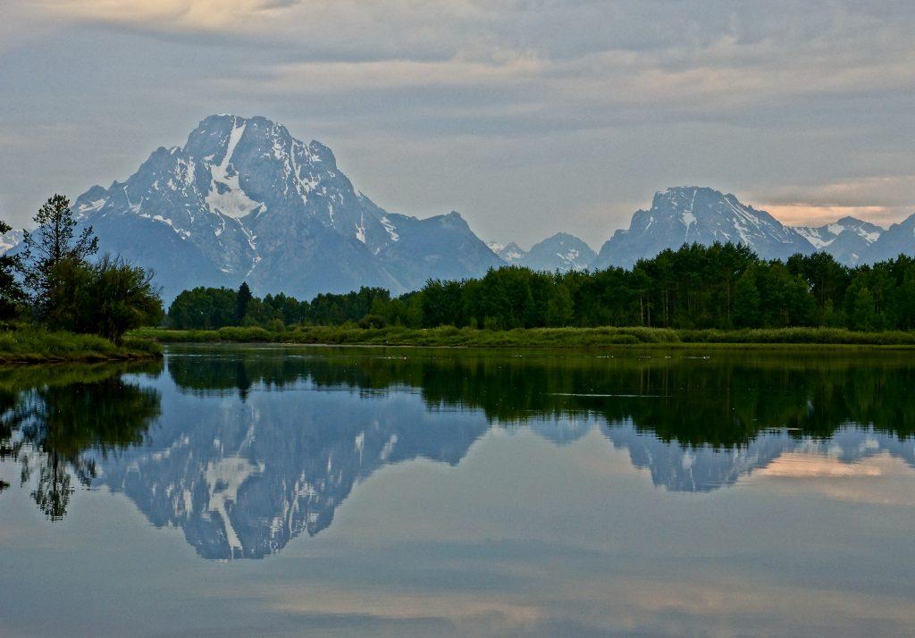 Mount Moran reflected in still water