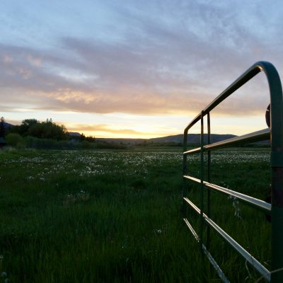 Sunset over Dubois pasture with open gate